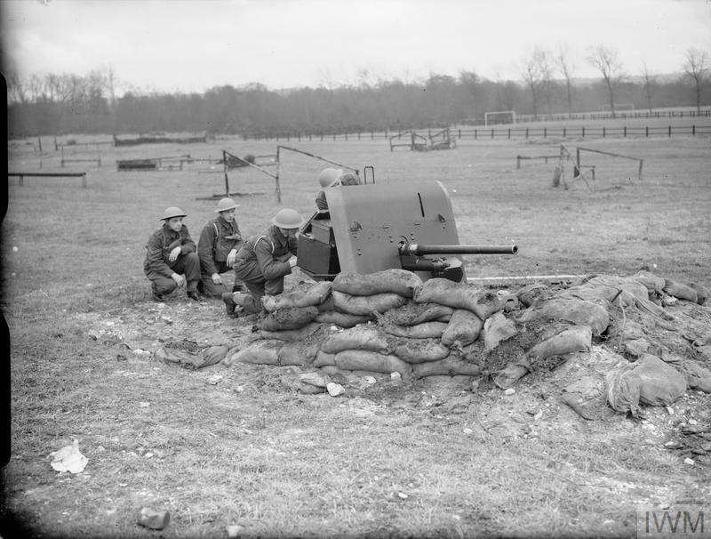 Gunners of the 1st Anti-Tank Regiment, Royal Canadian Artillery, with a 2-pdr anti-tank gun in a sandbagged position, Aldershot, December 1939. (Source: © IWM (H 948))