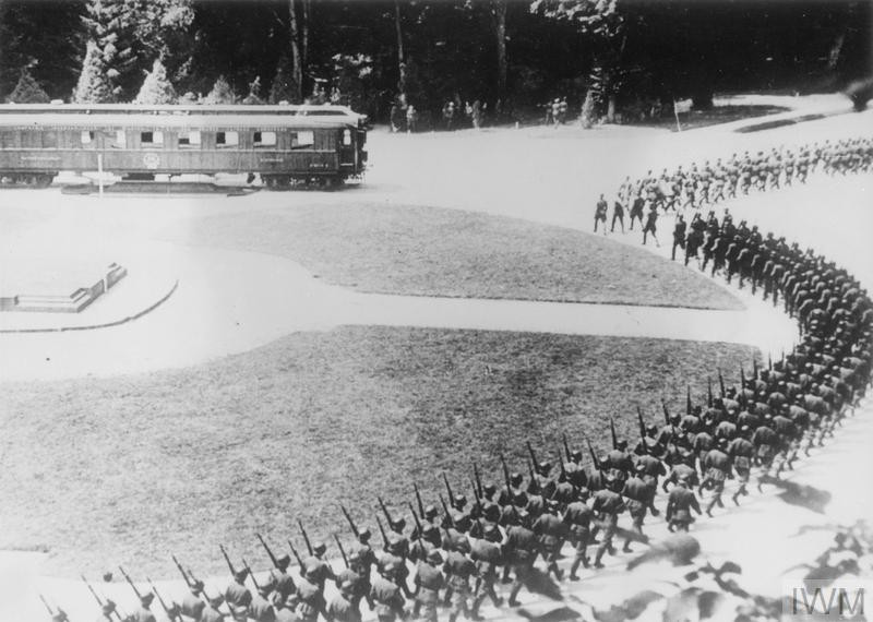 The historic railway carriage at Compiegne where Petain's Government signed Armistice Terms on 22 June 1940. A German guard of honour are seen marching round the carriage, 14 July 1940. (Source: © IWM (HU 93606))