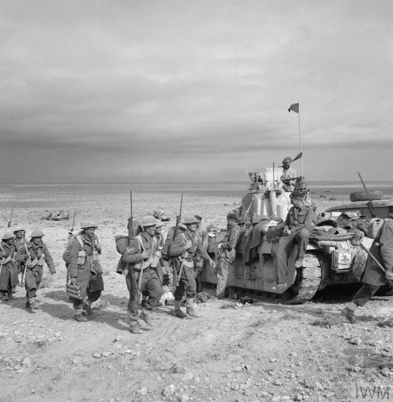 Infantry of the 2nd New Zealand Division link up with Matilda tanks of the Tobruk garrison during Operation CRUSADER, Libya, 2 December 1941. (Source: © IWM (E 6918))