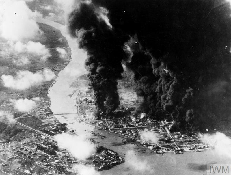Japanese oil going up in thick clouds of smoke during carrier-borne aircraft attack on Palembang refineries. (Source: © IWM (A 29242))