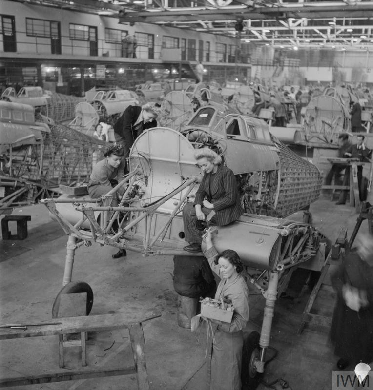 Winnie Bennett, Dolly Bennett, Florence Simpson and a colleague at work on the production of Hurricane fighter aircraft at a factory somewhere in Britain. (Source: © IWM (D 11126))