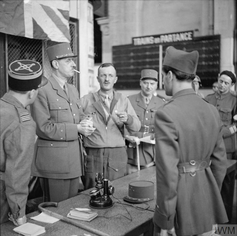 General De Gaulle with General Leclerc and other French officers at Montparnasse railway station in Paris, 25 August 1944. (Source: © IWM (BU 158))