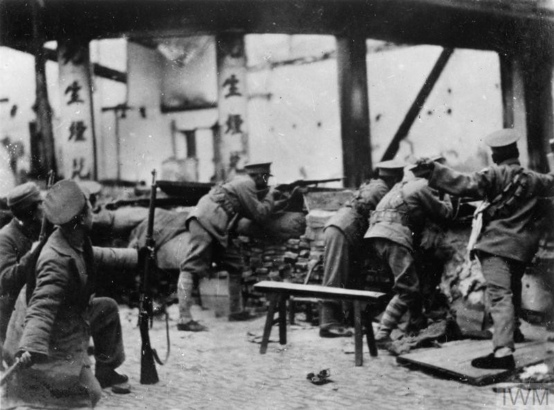 Chinese soldiers man a barricade in a factory during the Shanghai Incident of 1932. (Source: © IWM (HU 48784))