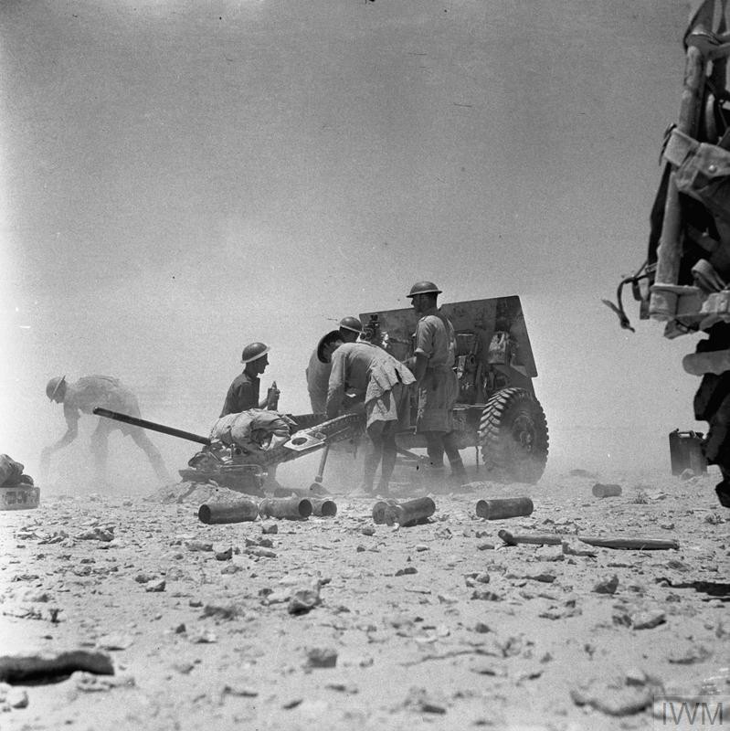 A 25-pdr field gun of 11th Field Regiment, Royal Artillery, in action during the First Battle of El Alamein, July 1942. (Source: © IWM (E 14114))