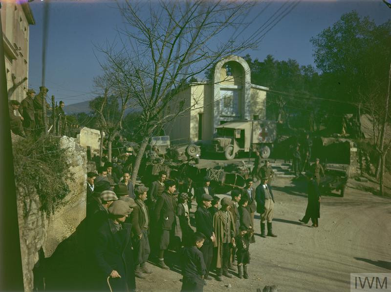 Street scene in the front line town of Lauro. The little village is crowded with British and Italian soldiers, ambulances, and all the varied vehicles of war. (Source: © IWM (TR 1513))