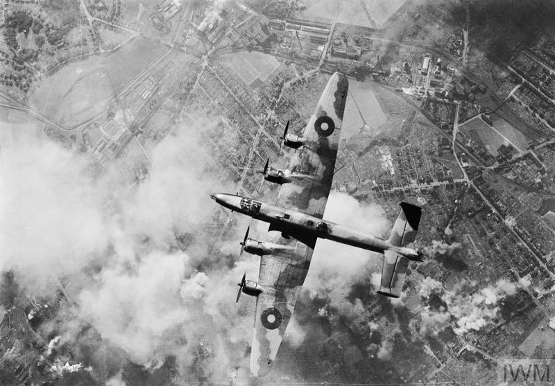 A Handley Page Halifax of No 6 Group flies over the smoke-obscured target during a daylight raid on the oil refinery at Wanne-Eickel in the Ruhr, 12 October 1944. 111 Halifaxes of 6 Group and 26 Avro Lancasters of No. 8 Group took part in the raid which destroyed a chemical factory but only inflicted minor damage on the refinery itself. (Source: © IWM (C 4713))