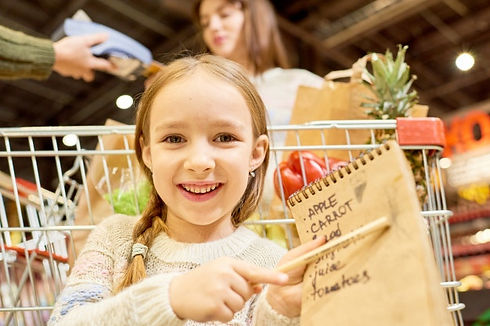 happy-little-girl-holding-shopping-list_