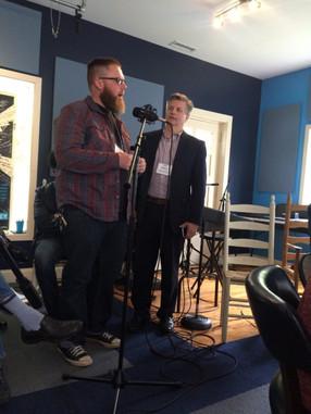 Eric inviting Adam to speak about healing through arts for veterans on ICRV radio