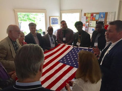 Eric-and-group-holding-flag-580x435