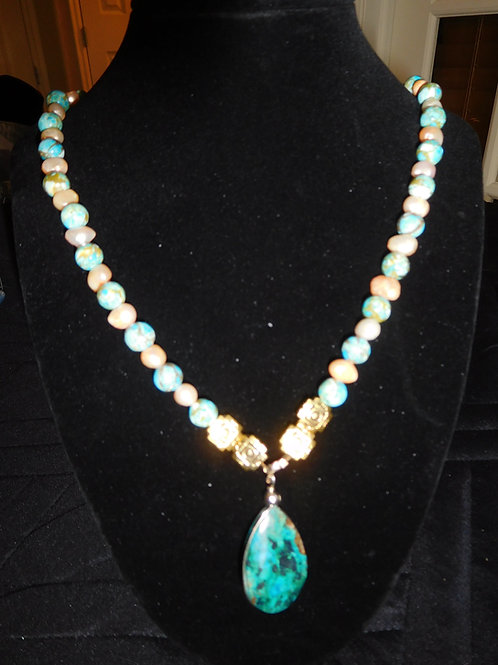 Necklace with Chrysocolla Pendant and small pearls.