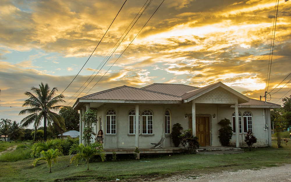 A tropical sunset illuminates the clouds above my host's home in a way that symbolizes their vigorous passion and love. Truly a welcoming home, I carry with me the lessons of love and family this home taught me in such a short visit.