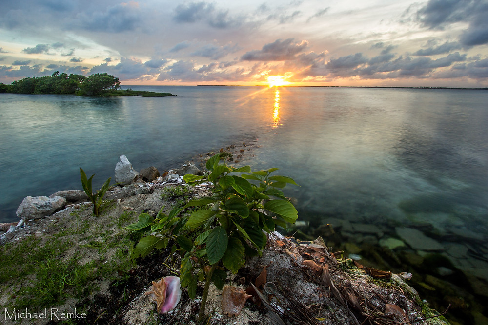 From Tobacco Caye in the heart of the Belize Barrier Reef, the Sun Sets over mainland Belize.
