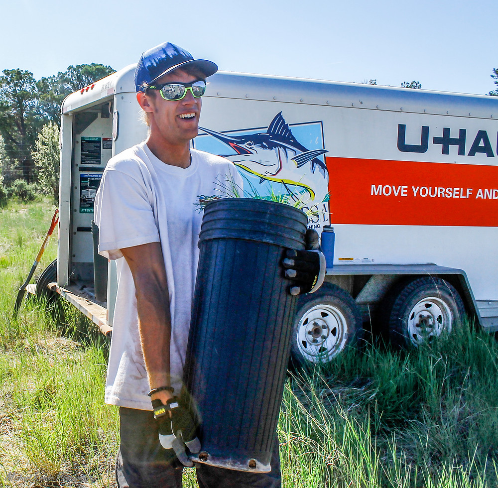 I unload pots from the UHUAL trailer, excited to be getting a good work out! Photo Courtesy of Emily Thompson