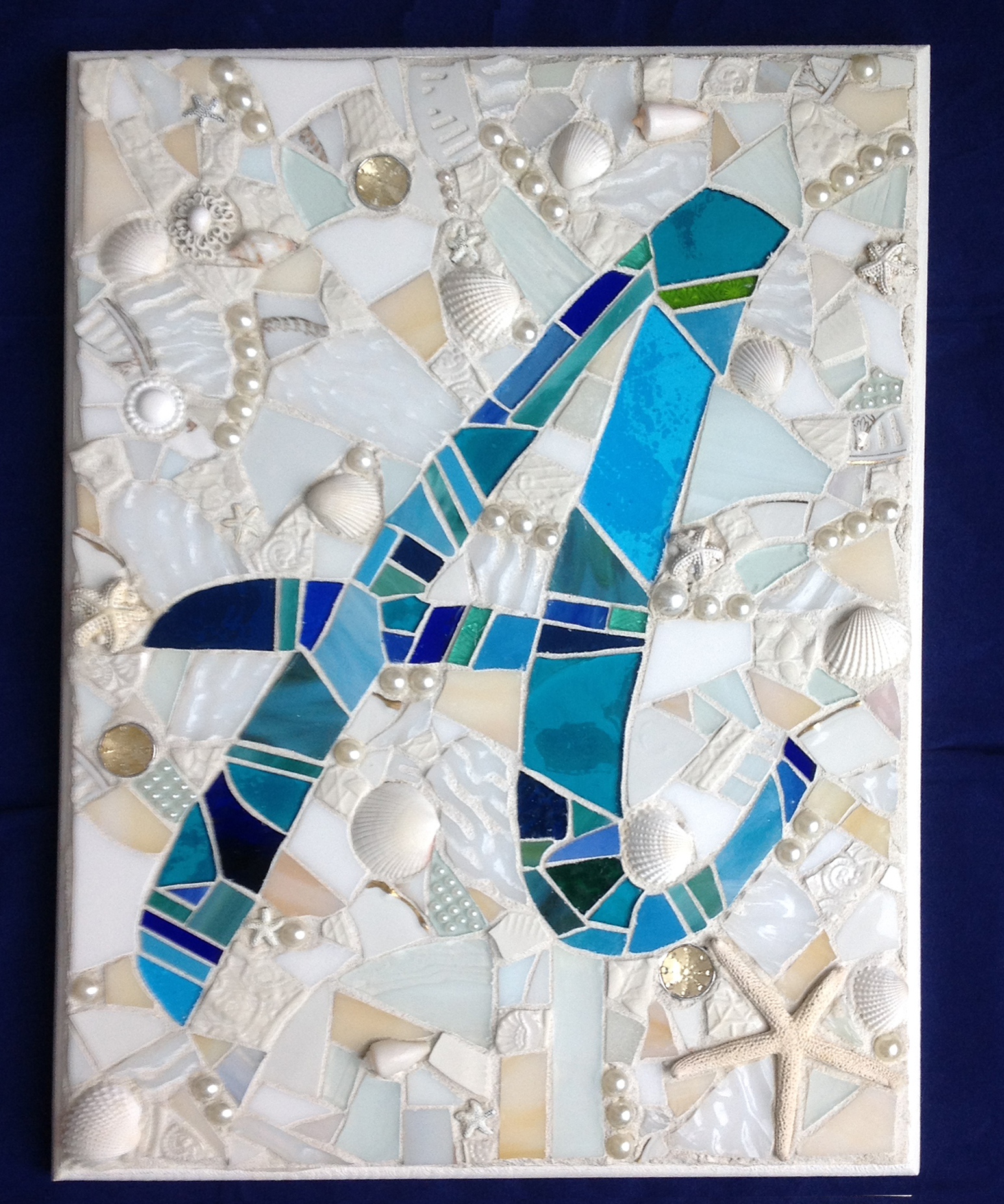 A monogram mosaic - beach theme with