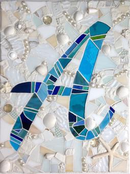 A mosaic with beach theme