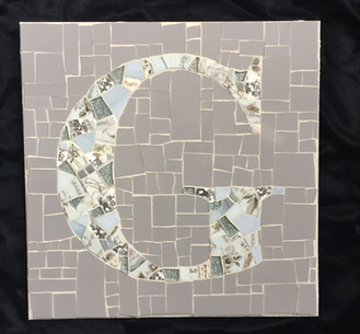 G monogram mosaic in grays
