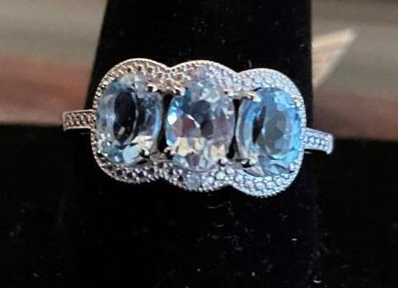 Oval Blue Topaz and Round White Diamond Simulate Ring. Size 12.