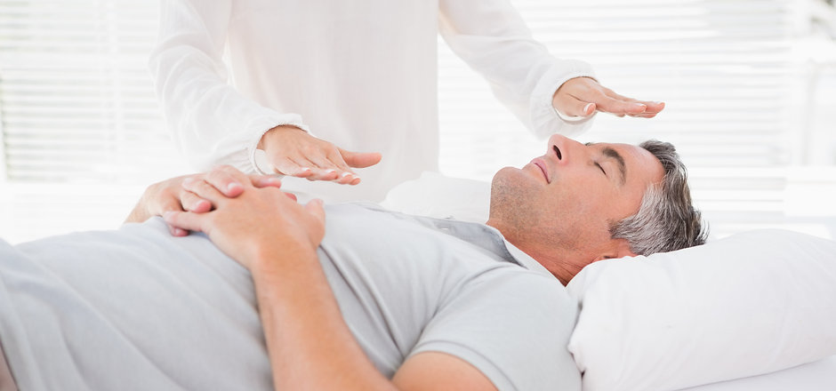 Therapist working with man in medical office.jpg