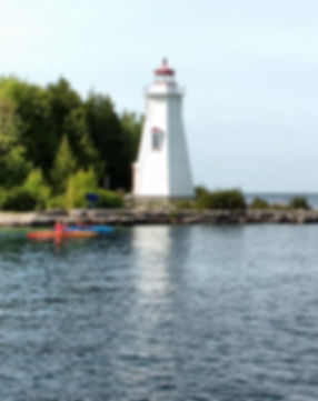 Kayaking past the Big Tub Lighthouse in Tobermory