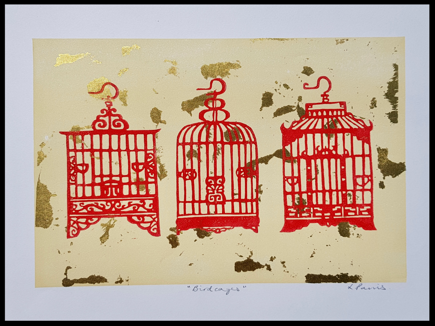 red birdcages with gold leaf