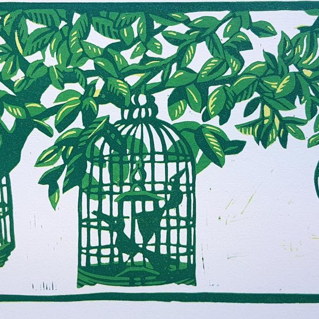 Birdcages hanging in tree