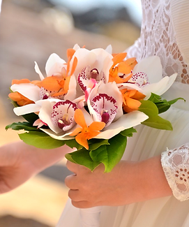 White cymbidium and orange mokara orchid bridal bouquet