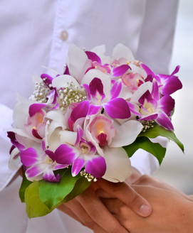 Bridal bouquet of purple orchids, white cymbidiums and baby's breath