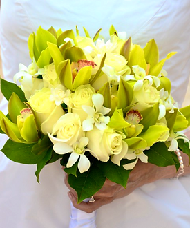 Green cymbidiums and cream roses with tuberose bouquet