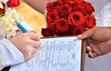 Signing the Hawaii wedding license