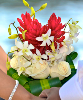 Red ginger, white orchids and cream roses in a ti leaf wrap