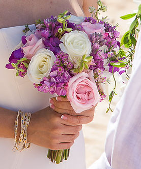 Pink and white rose with tuberose and purple orchids