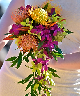 Pincushion protea bouquet with green and purple orchids