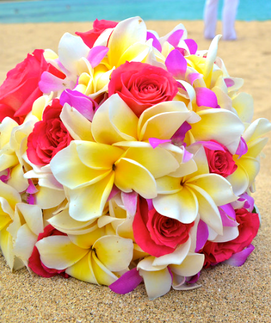 Bridal bouquet of hot pink roses, yellow plumeria and purple orchids