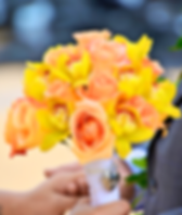 Orange rose and yellow cymbidium orchid bouquet