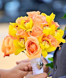 Orange rose and yellow cymbidium orchid bouquet