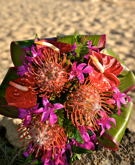 Red pincushion and orchids, ti-leaf wrap bouquet