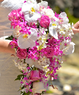 Large cascading orchid bouquet with roses