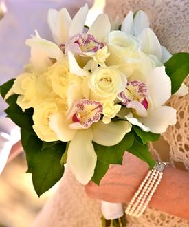 Cream rose and white cymbidium orchid bouquet