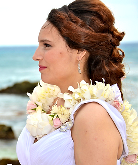 White orchid and baby pink rose leis