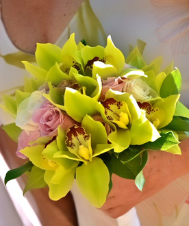 Green cymbidium bouquet with pink and white roses