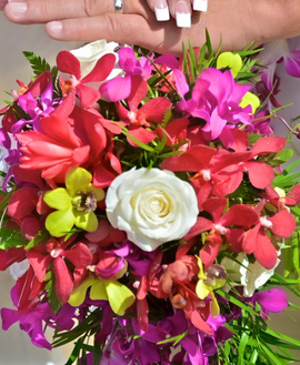 Red mokara, purple orchids and white rose bouquet