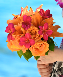 Orange rose, orange lilies and pink plumeria bouquet