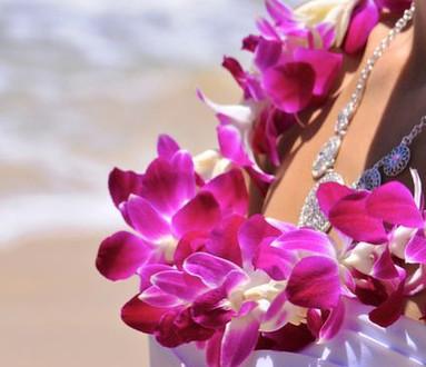 Purple orchid wedding leis