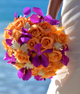Substantial orange rose and purple mokara bouquet with tuberose