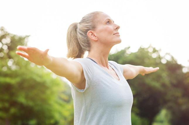 mature-woman-yoga-exercise-PTS6KYE.jpg