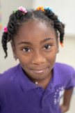 Portrait of Black Girl at Charter School Smiling
