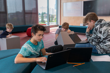 Seattle Academy Students on Laptops