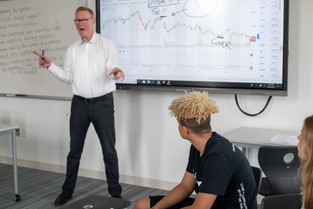 Seattle Academy Teacher Giving Lesson