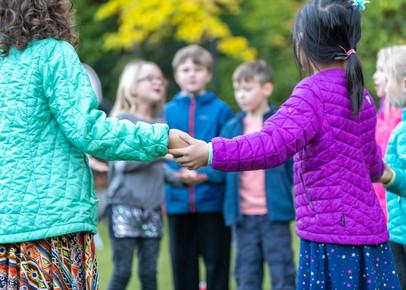 Children holding hands school