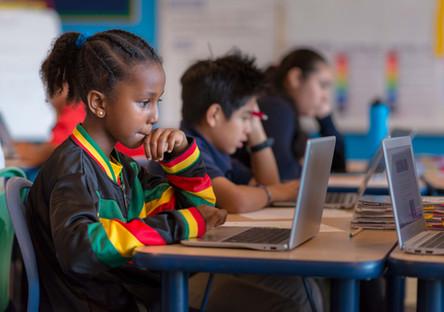 Charter School Girl on Laptop in Classroom